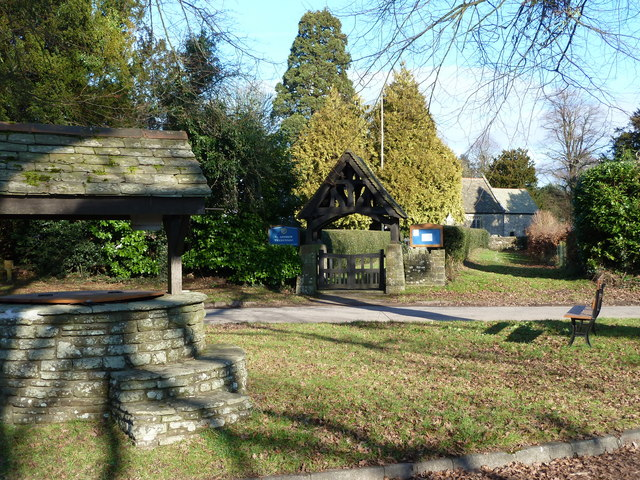 Village well, with church lych gate, Tredunnock