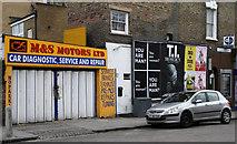 TQ3187 : Motors and Billboards by Martin Addison