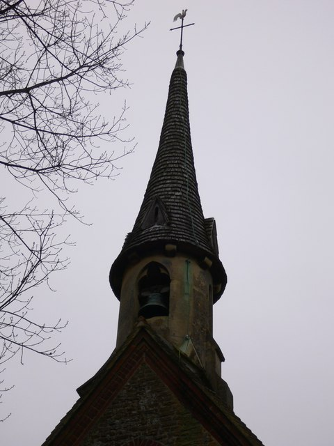 Grafham church steeple with bell and weather cock