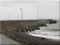 J3113 : Wave dodging at the Kilkeel Harbour Breakwater by Eric Jones
