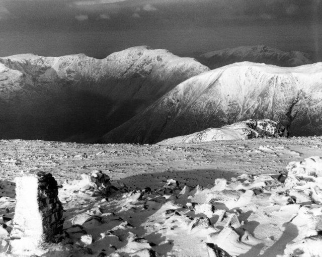 Scafell Pike trig point in winter raiment