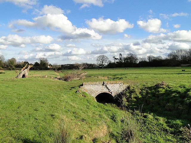 Small brick bridge over a stream at Thornage