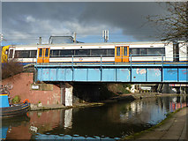 TQ2282 : The West London Line crosses the Grand Union Canal by Robin Webster