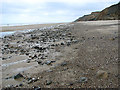 TG2639 : Sand and pebbles on the beach below Sidestrand by Evelyn Simak
