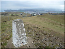 SH7683 : The trig point on the Great Orme looking south east by Jeremy Bolwell