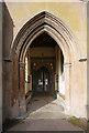 TL3746 : Holy Trinity, Meldreth - Porch by John Salmon