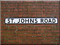 TM3863 : St John's Road sign by Adrian Cable