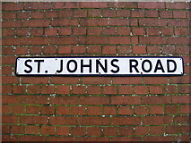 TM3863 : St John's Road sign by Geographer