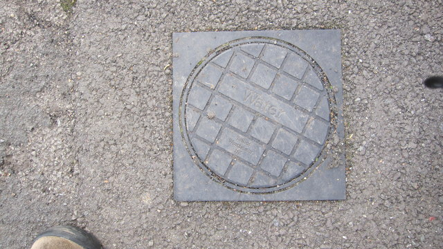 Water meter cover in pavement, Westfield