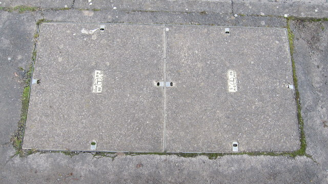 Telephone cable connection chamber cover in pavement, Westfield