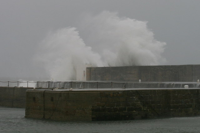 A double plume of salty spray is loosed over the harbour