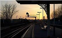 TQ2575 : Sunset, Wandsworth Town station by Derek Harper