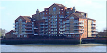 TQ2977 : Flats by the Thames by Thomas Nugent