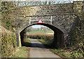 ST6048 : 2011 : Binegar Bottom passing under the old railway bridge by Maurice Pullin