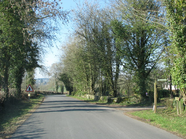 Road passes the start of the footpath to Cleddon