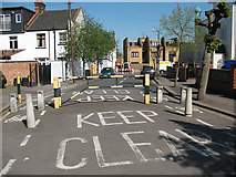 TQ2572 : Traffic barrier on Ryfold Road by Stephen Craven