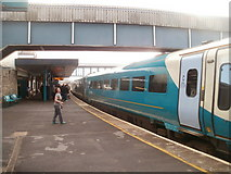SS7597 : Train to Manchester waits in Neath station by Jaggery