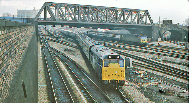 Scene at Old Oak Common East Junction, with a Class 31 Diesel on empty stock from Paddington