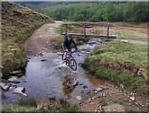 SK1695 : Fording Cranberry Clough by michael ely