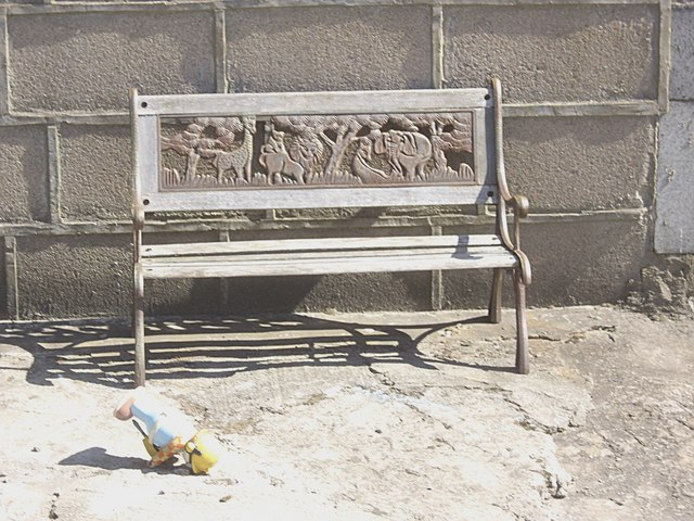 A carved wood bench seat in Footdee