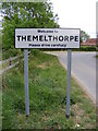 TG0524 : Themelthorpe Village name sign by Adrian Cable