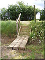 TM3054 : Steps & footbridge of the footpath to the B1438 Yarmouth Road by Adrian Cable