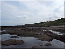 TA0487 : Southerly coastline from South Bay Scarborough by Leslie