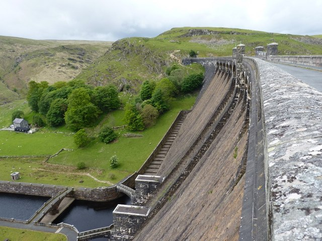 Along the top of the Claerwen dam wall