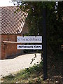 TG0528 : Nethergate House & Nethergate Farm Sign by Adrian Cable