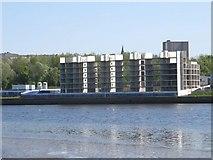 NZ2462 : New flats over the river by Bill Nicholls