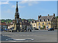 SE6183 : Mini roundabout, monument and market place by Pauline E