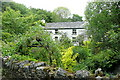 SX5079 : Garden in Mary Tavy by Graham Horn