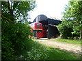 TF0700 : Buses at Sacrewell Lodge farm by Marathon