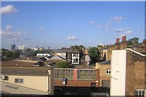 TQ2976 : Houses and rooftops from the train, near Wandsworth Road by Christopher Hilton