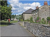 SE7485 : Approaching the village green, Sinnington by Pauline E