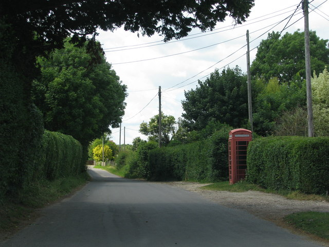 Road passes the phone box in Long Crichel
