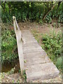 TM2356 : Footbridge of the footpath to Monewden Road by Adrian Cable