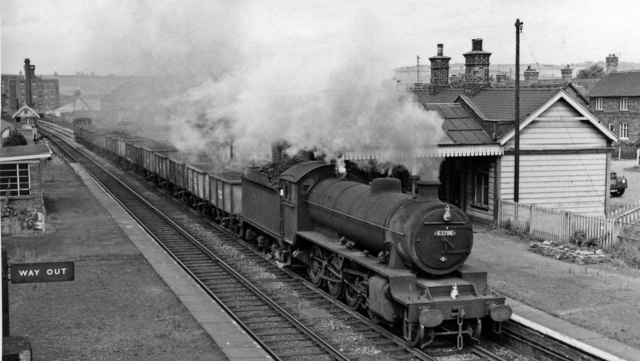 Up iron ore empties passing Killamarsh Central station
