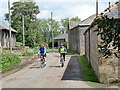 NU0002 : Cyclists passing through Warton by Oliver Dixon