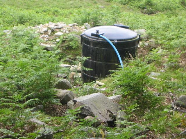 Water filtration tank on hill farm