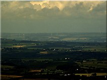 SS5141 : A distant view of Fullabrook Wind Farm as seen from Yes Tor, Dartmoor by Roger A Smith