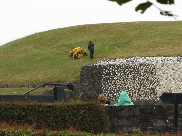 A remote control grass cutter on the roof of the Newgrange Tomb
