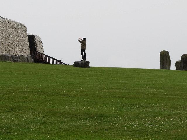 A statuesque photographer at Newgrange
