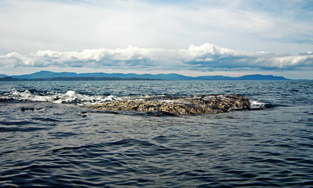 Murchadh Breac awash at low tide