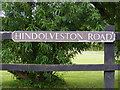 TG0325 : Hindolveston Road sign by Geographer