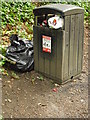 NZ2742 : litter bin on path by Bridge by rob bishop