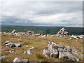 NY9635 : Cairn and rocks at Bollihope Carrs by Trevor Littlewood