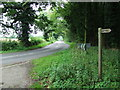 TL9791 : Road And Footpath Sign by Keith Evans