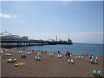 TQ3103 : Deckchairs on beach near Brighton Pier by Paul Gillett