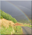 NM9228 : Glen Lonan road and rainbow by Peter Bond